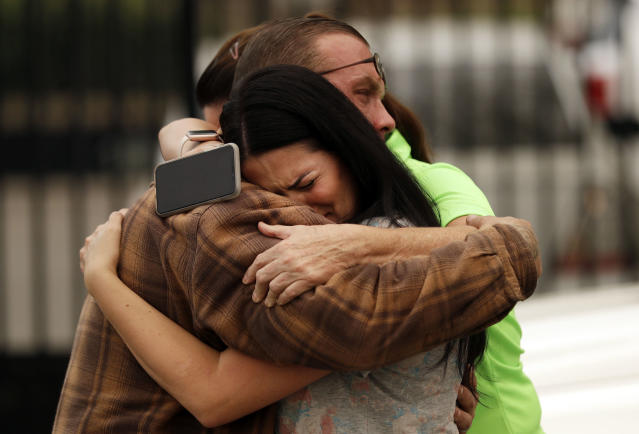<p>Friends of the Bledsoe family embrace outside of the sheriff's office in Redding, Calif., on Saturday, July 28, 2018, after hearing news of the death of Melody Bledsoe and her great-grandchildren James Roberts, 5, and Emily Roberts, 4, who were killed at their home by an advancing wildfire. (Photo: Marcio Jose Sanchez/AP) </p>