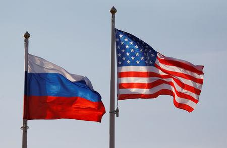 FILE PHOTO: National flags of Russia and the U.S. fly at Vnukovo International Airport in Moscow, Russia April 11, 2017.  REUTERS/Maxim Shemetov/File Photo