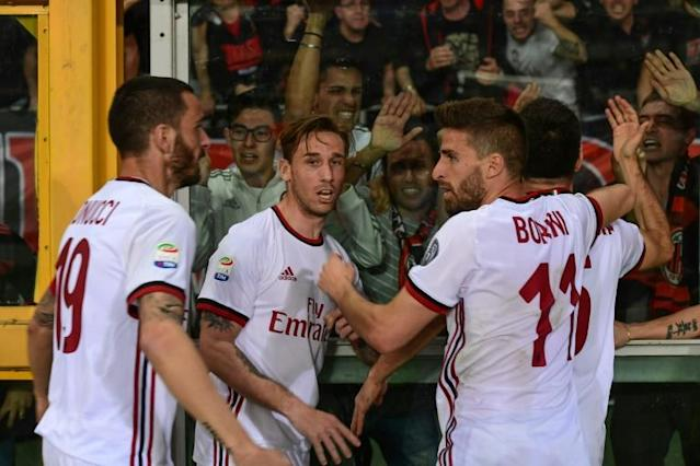 AC Milan players celebrate after Giacomo Bonaventura (Rear R) scored against Torino last week