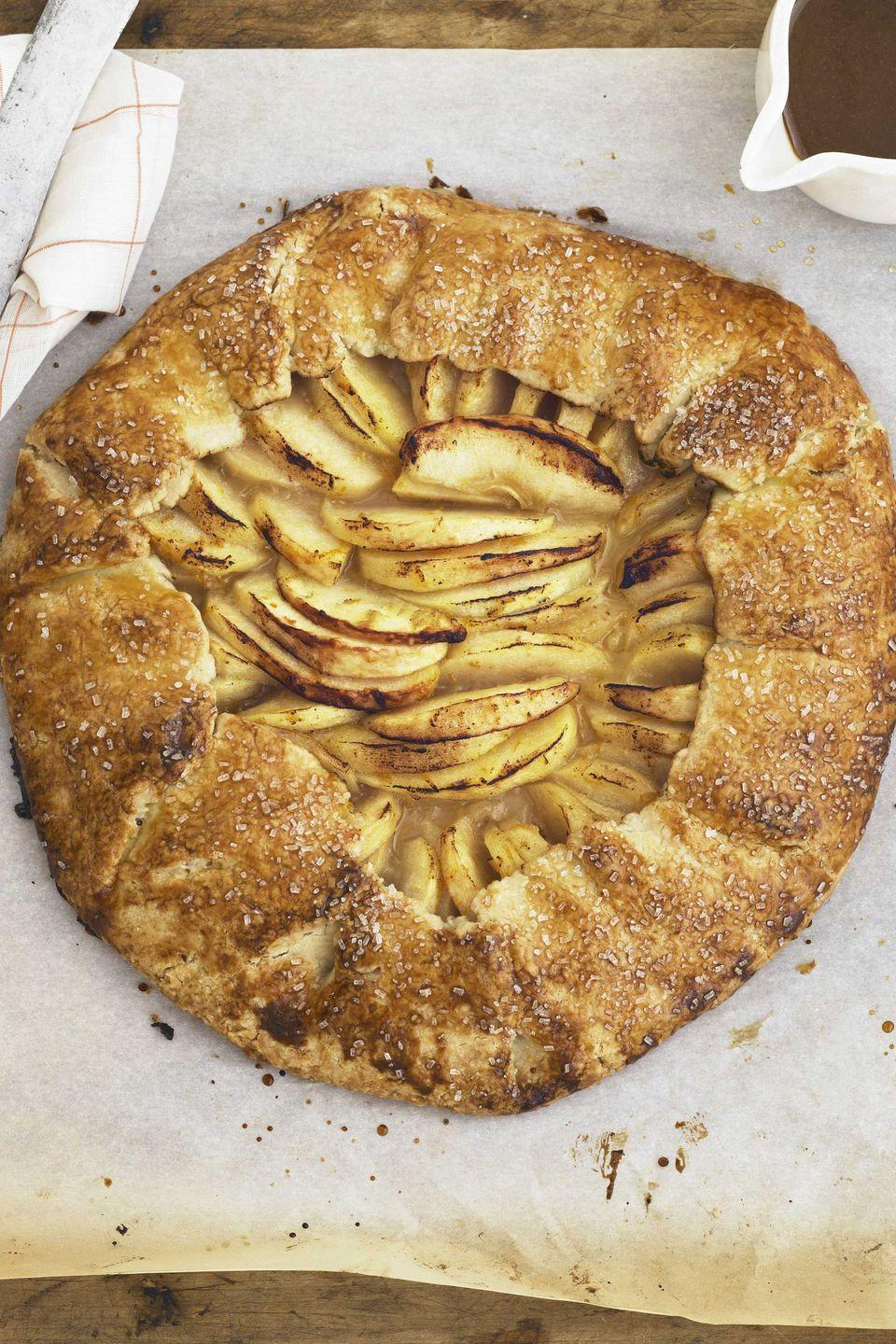 """<p>An apple galette is a classic fall dessert. This rustic version is paired with a butterscotch sauce spiked with Grand Marnier.</p><p><strong><a href=""""https://www.countryliving.com/food-drinks/recipes/a3454/rustic-apple-galette-recipe-clv0910/"""" rel=""""nofollow noopener"""" target=""""_blank"""" data-ylk=""""slk:Get the recipe"""" class=""""link rapid-noclick-resp"""">Get the recipe</a>.</strong></p>"""