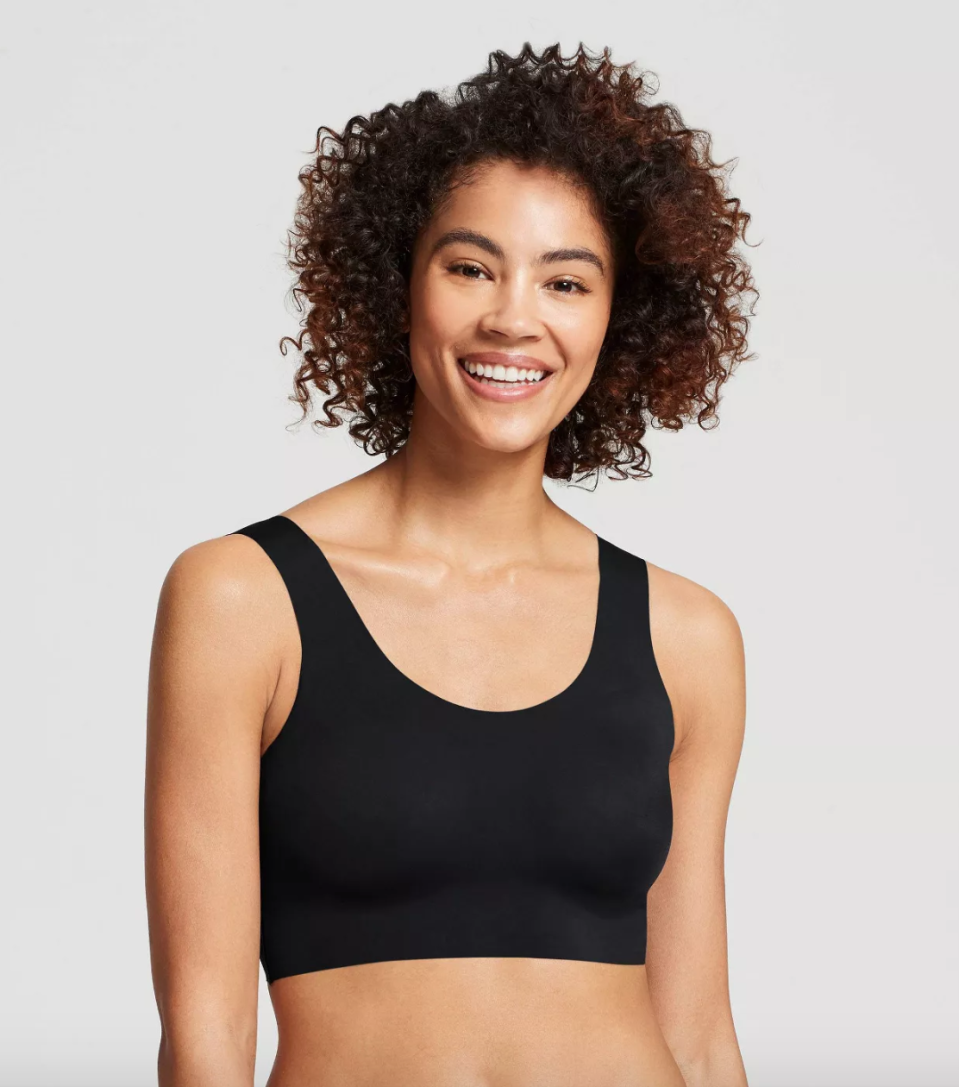 """<p><strong>True & Co.</strong></p><p>target.com</p><p><strong>$22.99</strong></p><p><a href=""""https://www.target.com/p/true-co-true-everybody-women-s-scoop-neck-bra/-/A-54236893"""" rel=""""nofollow noopener"""" target=""""_blank"""" data-ylk=""""slk:Shop Now"""" class=""""link rapid-noclick-resp"""">Shop Now</a></p><p>True & Co. brings comfort and structure all in their brasiers. They've got great wireless bras that you can lounge in, while still giving the uplift you need. </p>"""