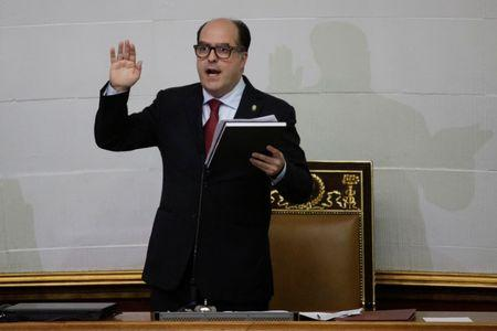 Julio Borges, deputy of Venezuelan coalition of opposition parties, takes the oath after being elected president of the National Assembly in Caracas