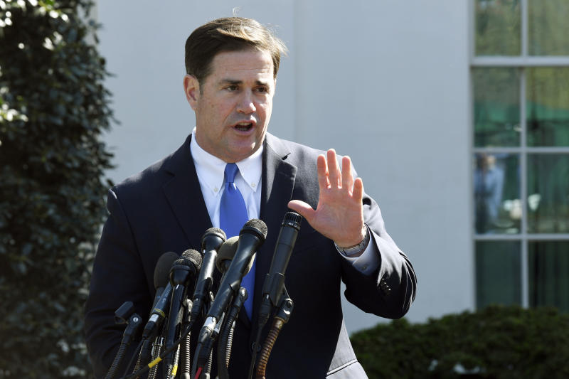 FILE - In this April 3, 2019 file photo, Arizona Gov. Doug Ducey talks to reporters outside the West Wing of the White House in Washington following a meeting with President Donald Trump. It's not just Democratic-leaning states at risk of losing federal money and clout in Congress if the Supreme Court says the upcoming census can include a citizenship question. Fast-growing Arizona, Florida and Texas all have large groups of immigrants, especially Hispanics, who might choose to sit out the census, but are led by Republicans who seem unconcerned about the potential for an undercount and the resulting loss of representation in Congress. (AP Photo/Susan Walsh, File)