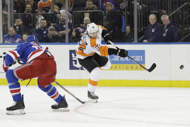 Philadelphia Flyers' Nicolas Aube-Kubel takes a shot during the third period of the NHL hockey game against the New York Rangers, Sunday, March 1, 2020, in New York. The Flyers defeated the Rangers 5-3. (AP Photo/Seth Wenig)