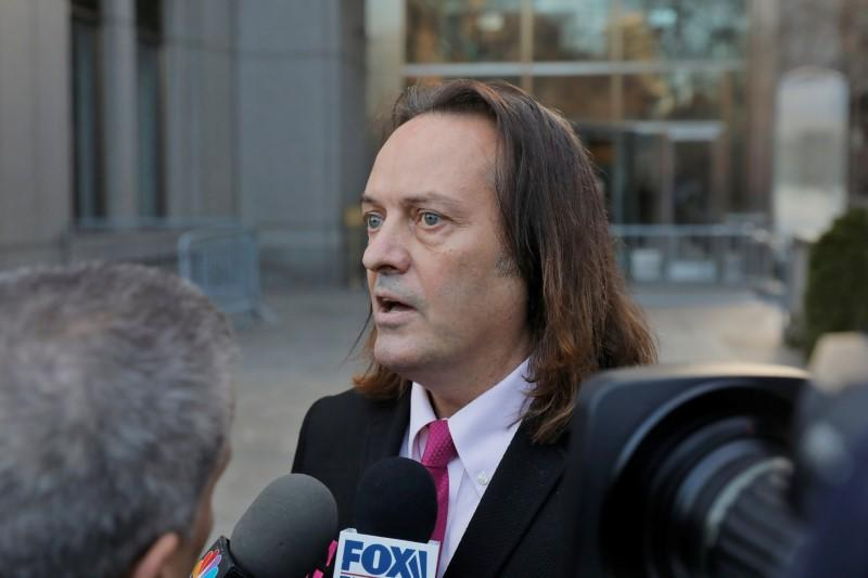 T-Mobile US Inc CEO John Legere departs a hearing at Manhattan Federal Court in New York City