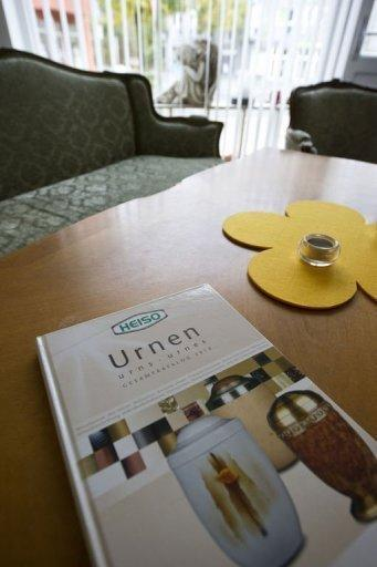 A catalogue for funeral urns lie on a table in burial firm Aarau. Some opt for a cut-price funeral because they are burying a distant relative; others because of geographical distance and the rest cite financial reasons