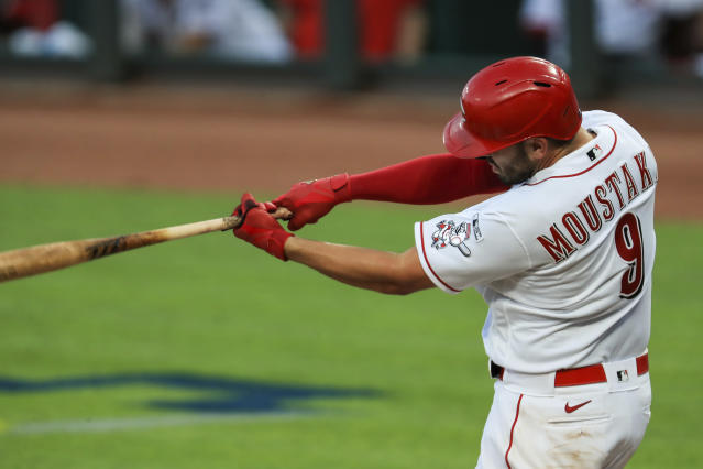 Cincinnati Reds' Mike Moustakas (9) hits a two-run home run in the seventh inning during a baseball game against the Detroit Tigers at Great American Ballpark in Cincinnati, Friday, July 24, 2020. The Reds won 7-1. (AP Photo/Aaron Doster)