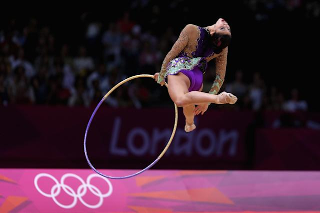 LONDON, ENGLAND - AUGUST 09: Julie Zetlin of USA performs during the Rhythmic Gymnastics qualification on Day 13 of the London 2012 Olympics Games at Wembley Arena on August 9, 2012 in London, England. (Photo by Julian Finney/Getty Images)