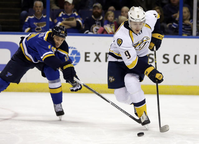 Nashville Predators' Filip Forsberg, of Sweden, controls the puck as St. Louis Blues' Jay Bouwmeester, left, defends during the first period of an NHL hockey game Thursday, Nov. 13, 2014, in St. Louis. (AP Photo/Jeff Roberson)