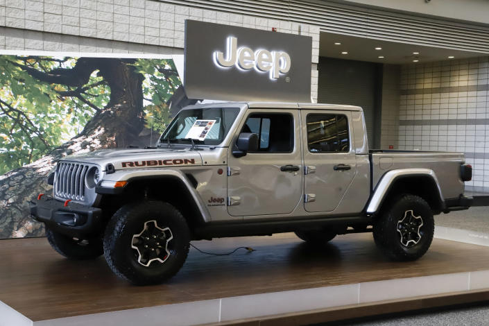 FILE- This Feb. 14, 2019, file photo shows a 2020 Jeep Gladiator on display at the 2019 Pittsburgh International Auto Show in Pittsburgh. The Jeep Gladiator boasts impressive off-road ability, a roomy rear seat and a high maximum towing capacity. (AP Photo/Gene J. Puskar, File)