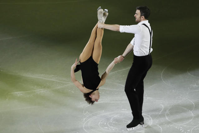 Meagan Duhamel and Eric Radford of Canada perform during the figure skating exhibition gala in the Gangneung Ice Arena at the 2018 Winter Olympics in Gangneung, South Korea, Sunday, Feb. 25, 2018. (AP Photo/Felipe Dana)