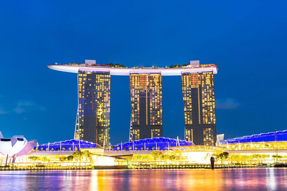 """<p>Singapore's most iconic <a href=""""https://www.housebeautiful.com/uk/lifestyle/g28348335/beautiful-hotel-bathrooms/"""" rel=""""nofollow noopener"""" target=""""_blank"""" data-ylk=""""slk:hotel"""" class=""""link rapid-noclick-resp"""">hotel</a> took the second spot, famed for its award-winning dining, large rooftop infinity pool, and breathtaking views of the Singapore skyline. It's definitely one to add to your must-visit list once it's safe to travel...<br></p>"""