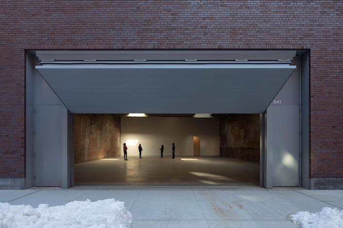 At the newly renovated Dia Chelsea, a gallery's metal gate nods to the industrial building's original garage door.