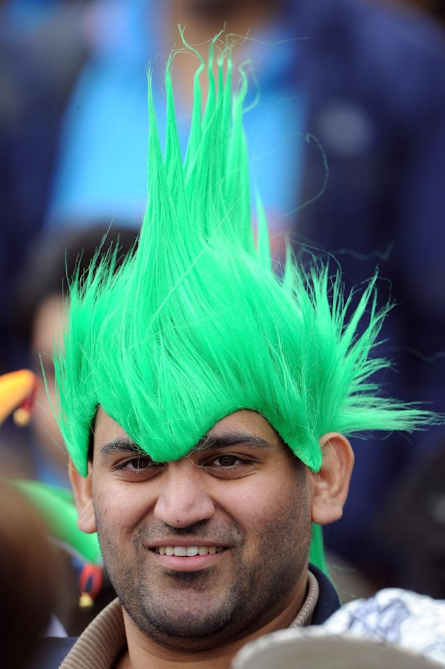 A fan attends the 2013 ICC Champions Trophy cricket match between Pakistan and India at Edgbaston in Birmingham, central England, on June 15, 2013. AFP PHOTO/ANDREW YATES