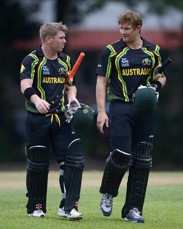 COLOMBO, SRI LANKA - SEPTEMBER 15:  David Warner and Shane Watson of Australia leave the field after the T20 World Cup Warm Up Match between Australia and New Zealand at Nondescripts Cricket Club on September 15, 2012 in Colombo, Sri Lanka.  (Photo by Gareth Copley/Getty Images,)