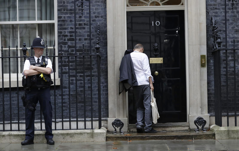 """Dominic Cummings, political adviser to Britain's Prime Minister Boris Johnson, arrives at 10 Downing Street in London, Thursday, Sept. 26, 2019. An unrepentant Prime Minister Boris Johnson brushed off cries of """"Resign!"""" and dared his foes to try to topple him Wednesday at a raucous session of Parliament, a day after Britain's highest court ruled he acted illegally in suspending the body ahead of the Brexit deadline. (AP Photo/Kirsty Wigglesworth)"""