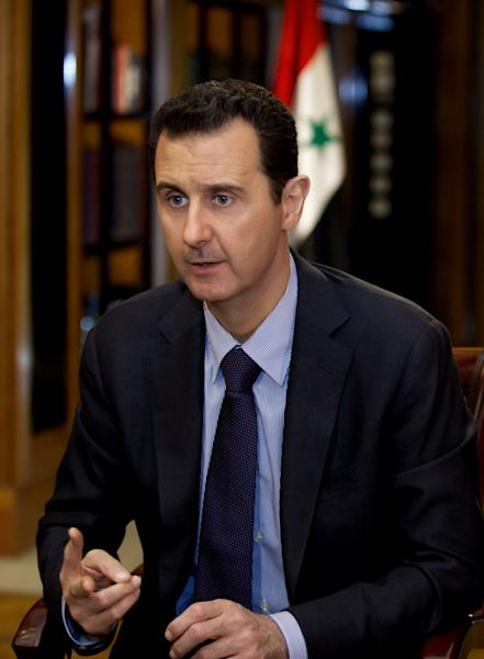 FILE - In this Monday, Oct. 21, 2013 file photo, which AP obtained from Syrian official news agency SANA and which has been authenticated based on its contents and other AP reporting, President Bashar Assad gestures as he speaks during an interview with Lebanon's Al-Mayadeen TV, at the presidential palace in Damascus, Syria. The 48-year-old Assad has led Syria since 2000, taking over as president after the death of his father, Hafez, who ruled the country for some 30 years. Assad, who trained in London as an ophthalmologist, and came to power through a twist of fate: his oldest brother Basil who had been groomed to succeed their father was killed in car accident in 1994, leaving Bashar as the next in line. (AP Photo/SANA, File)