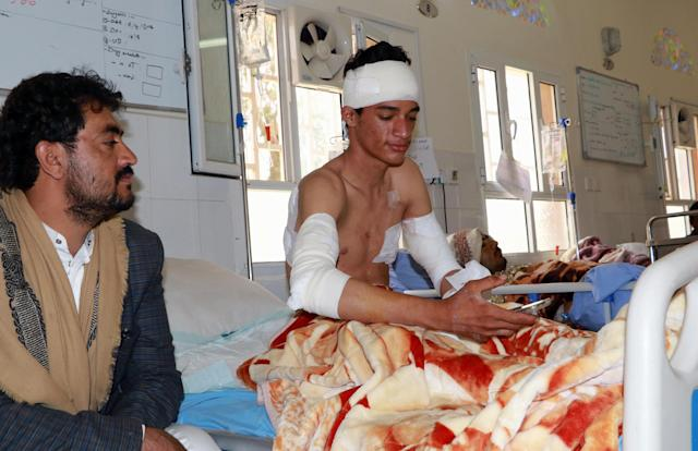 <p>A Yemeni youth wounded in an air strike by coalition forces the previous day on a bus at a market in rebel-held northern Yemen, lies on his hospital in the Yemeni city of Saada on Aug. 10, 2018. (Photo: Stringer/AFP/Getty Images) </p>