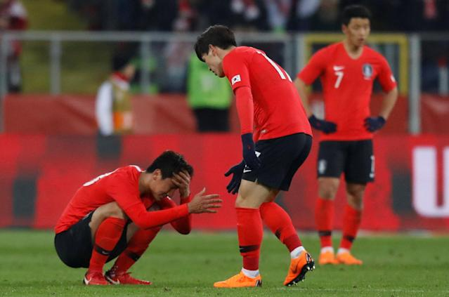Soccer Football - International Friendly - Poland vs South Korea - Silesian Stadium, Chorzow, Poland - March 27, 2018 South Korea's Lee Chang-min consoles teammate Jung Woo-Young after the match REUTERS/Kacper Pempel