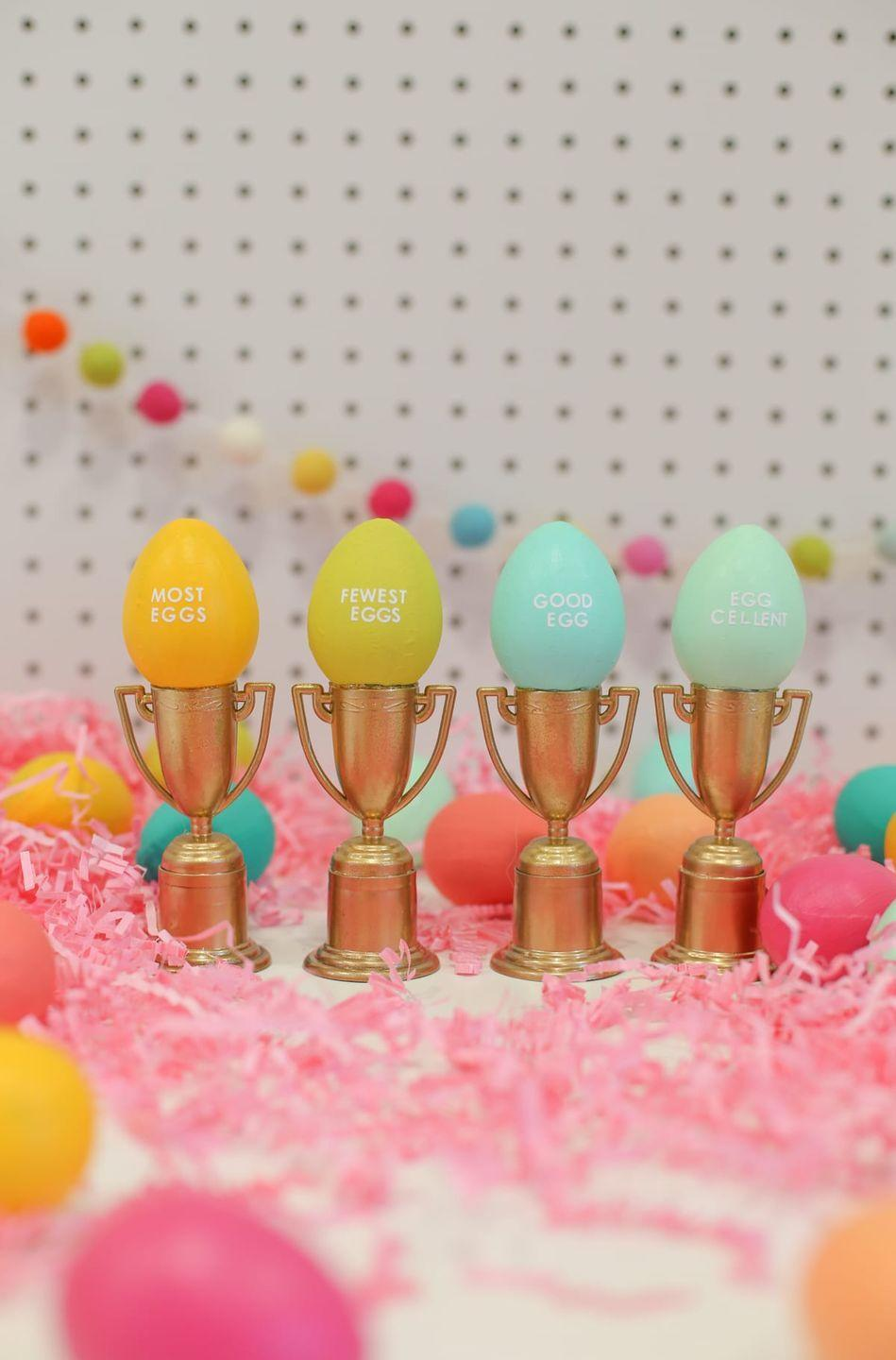 "<p>While the chocolates, trinkets, and coins may be the main draw, everyone will feel like a winner when they're given one of these small (but mighty) trophies that read ""Good Egg,"" ""Most Eggs,"" and more. </p><p><em><a href=""https://lovelyindeed.com/make-these-tiny-trophies-for-your-easter-egg-hunts/"" rel=""nofollow noopener"" target=""_blank"" data-ylk=""slk:Get the tutorial at Lovely Indeed »"" class=""link rapid-noclick-resp"">Get the tutorial at Lovely Indeed »</a></em></p><p><strong>RELATED: </strong><a href=""https://www.goodhousekeeping.com/holidays/easter-ideas/a26754736/best-easter-egg-hunt-nyc/"" rel=""nofollow noopener"" target=""_blank"" data-ylk=""slk:The Best Easter Egg Hunts Near You"" class=""link rapid-noclick-resp"">The Best Easter Egg Hunts Near You</a><br></p>"