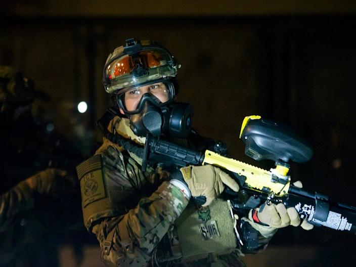 An ICE officer wore US military camouflage on July 29 in Portland.