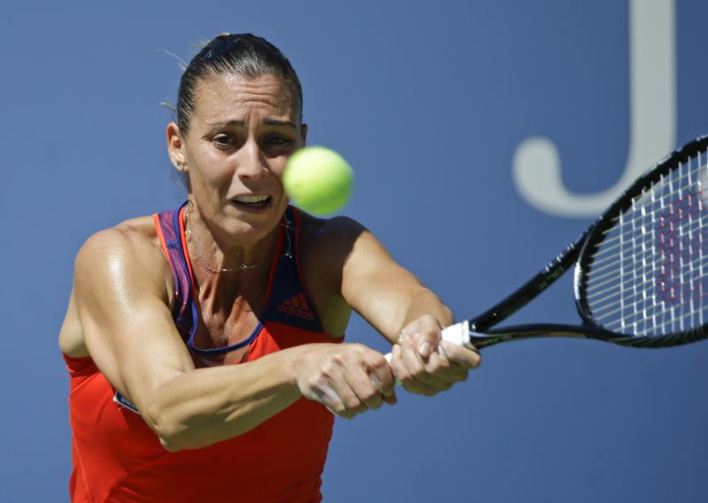 Flavia Pennetta, of Italy, returns a shot to Roberta Vinci, of Italy, during the quarterfinals of the 2013 U.S. Open tennis tournament, Wednesday, Sept. 4, 2013, in New York. (AP Photo/Kathy Willens)