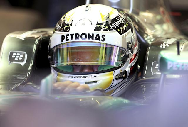 Mercedes driver Lewis Hamilton of Britain waits in his car in his team garage during the third practice session for the Singapore Formula One Grand Prix on the Marina Bay City Circuit in Singapore, Saturday, Sept. 21, 2013. (AP Photo/Wong Maye-E)