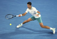 Serbia's Novak Djokovic hits a forehand to Russia's Daniil Medvedev during the men's singles final at the Australian Open tennis championship in Melbourne, Australia, Sunday, Feb. 21, 2021. (AP Photo/Hamish Blair)