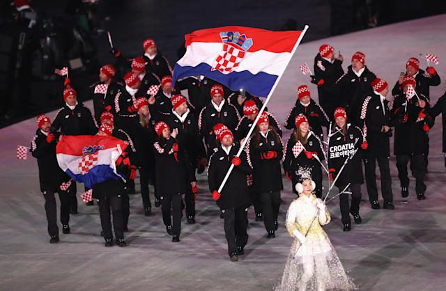<p>Flag bearer Natko Zrncic-Dim of Croatia leads the team during the Opening Ceremony of the PyeongChang 2018 Winter Olympic Games at PyeongChang Olympic Stadium on February 9, 2018 in Pyeongchang-gun, South Korea. (Photo by Ronald Martinez/Getty Images) </p>