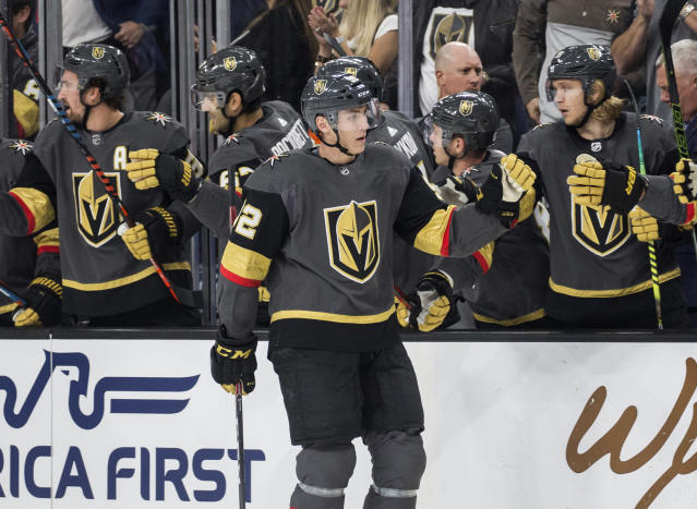 Vegas Golden Knights left wing Tomas Nosek (92) celebrates with teammates after scoring a goal during the first period of the team's NHL hockey game against the Calgary Flames on Saturday, Oct. 12, 2019, in Las Vegas. (AP Photo/Benjamin Hager)