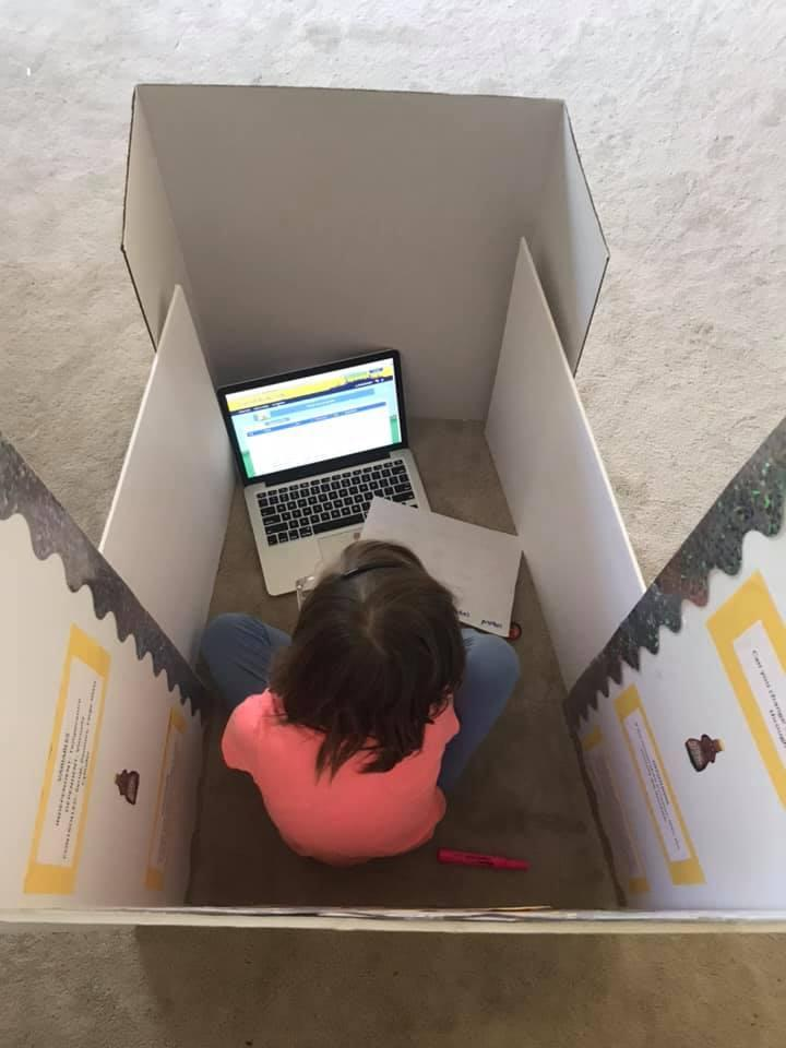 Ashley also shared a snap of her new system that ensures she never walks through the back of her daughter's Zoom meetings. Photo: Facebook/Ashley Smith