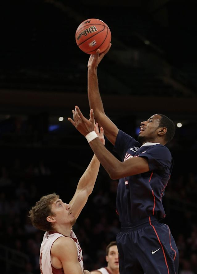 Connecticut's DeAndre Daniels, right, shoots over Boston College's Eddie Odio during the first half of an NCAA college basketball game on Thursday, Nov. 21, 2013, in New York. (AP Photo/Seth Wenig)