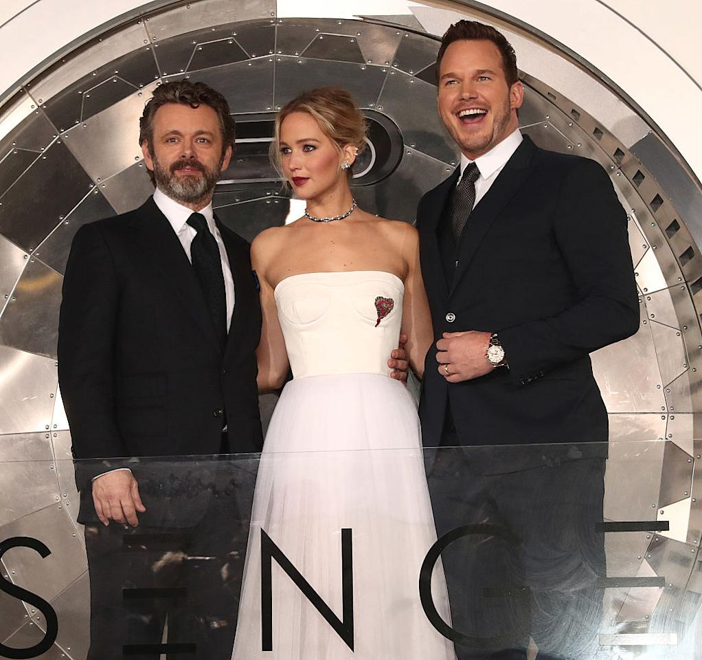 <p>Michael Sheen, Jennifer Lawrence, and Chris Pratt on Dec. 14. Lawrence and Pratt play two deep-space travelers who wake up too early from hibernation, and Sheen plays the ship's android bartender. (Photo: Getty Images) </p>
