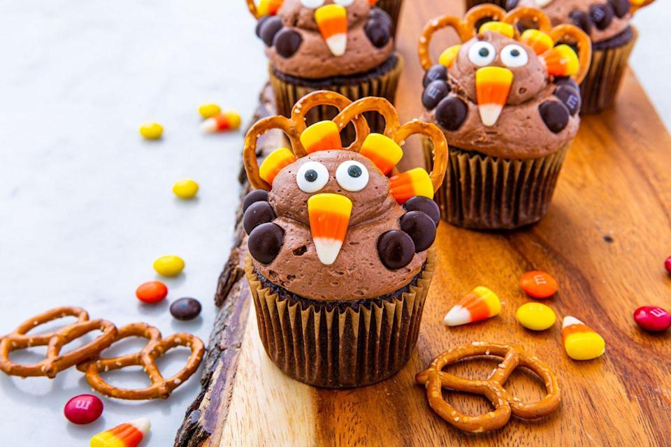 "<p>These are an art project and a Thanksgiving Day dessert in one. </p><p><a class=""link rapid-noclick-resp"" href=""https://www.delish.com/holiday-recipes/thanksgiving/a29368652/turkey-cupcakes-recipe/"" rel=""nofollow noopener"" target=""_blank"" data-ylk=""slk:Make The Craft From Delish"">Make The Craft From Delish</a> </p>"