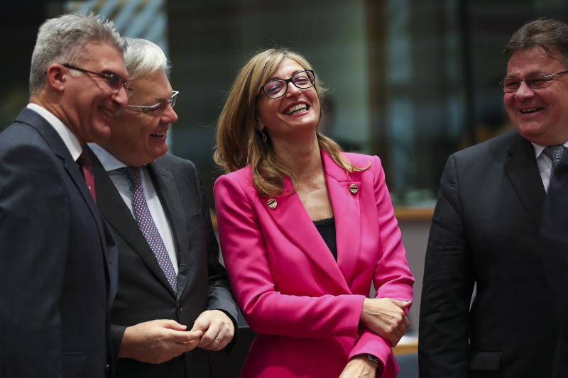 Bulgarian Foreign Minister Ekaterina Zaharieva, second right, talks to Malta's Foreign Minister Carmelo Abela, left, Lithuanian Foreign Minister Linas Linkevicius, right, and Belgium Foreign Minister Didier Reynders during an European Foreign Affairs Ministers meeting at the Europa building in Brussels, Monday, Nov. 11, 2019. European Union foreign ministers are discussing ways to keep the Iran nuclear deal intact after the Islamic Republic began enrichment work at its Fordo power plant. (AP Photo/Francisco Seco)