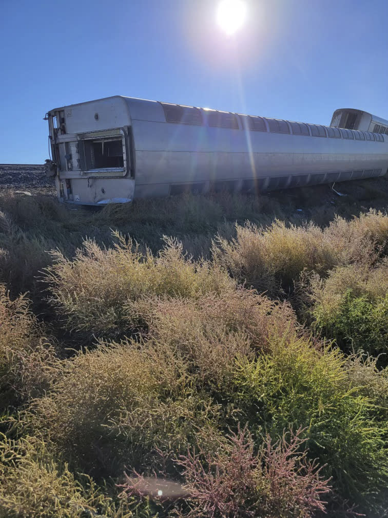 This photo provided by Kimberly Fossen shows an Amtrak train that derailed on Saturday, Sept. 25, 2021, in north-central Montana. Multiple people were injured when the train that runs between Seattle and Chicago derailed Saturday, the train agency said. (Kimberly Fossen via AP)
