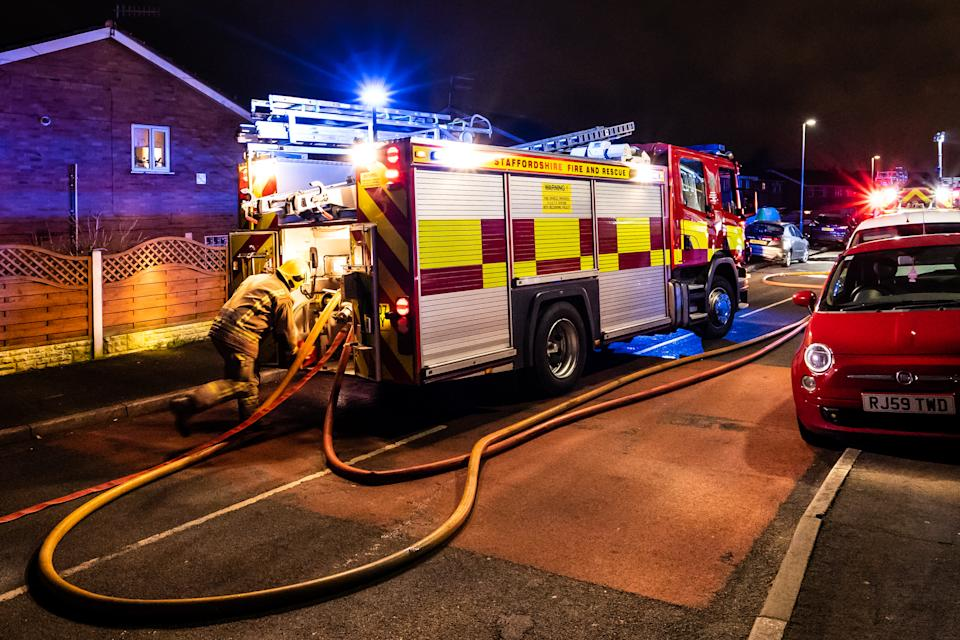 Meir Hay, Stoke on Trent, Staffordshire - 16th February 2019 - Fire engines and firemen attend an emergency house fire on a quiet housing estate in the city caused by a fault washing machine wiring