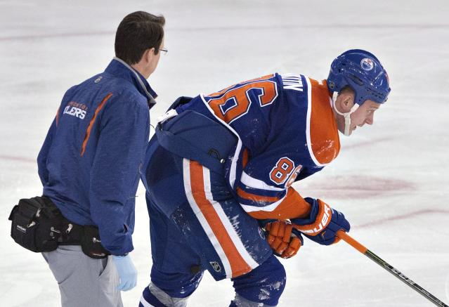 Edmonton Oilers' Nikita Nikitin leaves the ice after an injury during the third period of an NHL hockey game against the Buffalo Sabres on Thursday, Jan. 29, 2015, in Edmonton, Alberta. (AP Photo/The Canadian Press, Jason Franson)