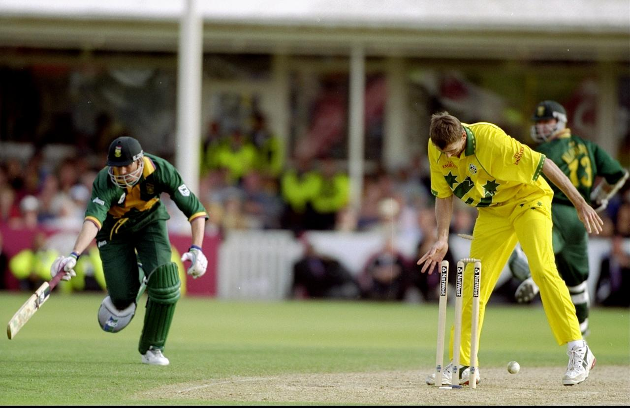 17 Jun 1999:  Glenn McGrath of Australia runs out Steve Elworthy of South Africa in the World Cup semi-final at Edgbaston in Birmingham, England. The match finished a tie as Australia went through after finishing higher in the Super Six table. \ MandatoryCredit: Craig Prentis /Allsport