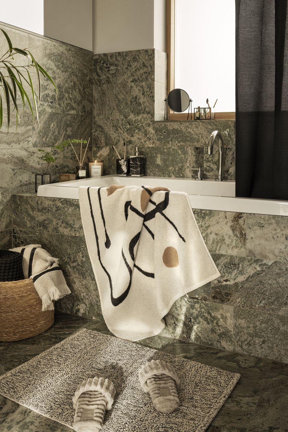 """<p>A bathroom can often be the harshest feeling room in the house, however, adding soft, textured bath mats and abstract towels is a chic way of bringing in extra warmth and wrapping yourself up in comfort. </p><p><a class=""""link rapid-noclick-resp"""" href=""""https://go.redirectingat.com?id=127X1599956&url=https%3A%2F%2Fwww2.hm.com%2Fen_gb%2Fhome%2Fshop-by-room%2Fbathroom.html&sref=https%3A%2F%2Fwww.prima.co.uk%2Fhome-ideas%2Fhome-accessories-buys%2Fg37325647%2Fhandm-home-autumn-collection%2F"""" rel=""""nofollow noopener"""" target=""""_blank"""" data-ylk=""""slk:Shop more bathroom interiors at H&M"""">Shop more bathroom interiors at H&M</a></p>"""