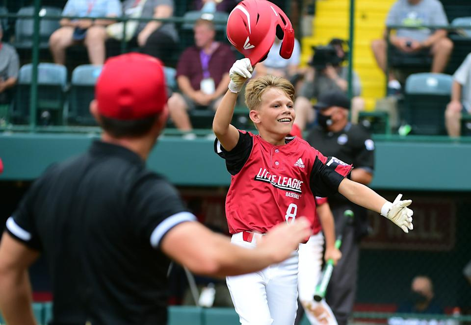 Hamilton West Side's Krew Brown (8) reacts after scoring a run in the second inning during the semifinals of the Little League World Series.