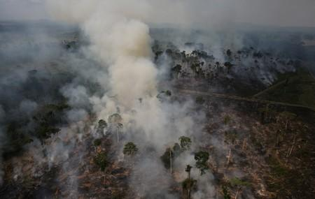 FILE PHOTO: An aerial view of a tract of Amazon jungle burning as it is being cleared by loggers and farmers near the city of Novo Progresso
