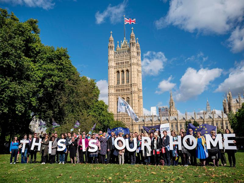 Demonstrators hold banners during a protest to lobby MPs to guarantee the rights of EU citizens living in the UK, after Brexit, outside the Houses of Parliament: AFP