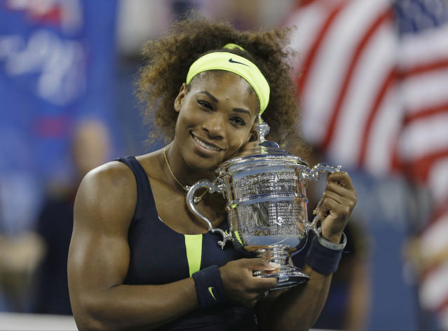 Serena Williams holds the championship trophy after beating Victoria Azarenka, of Belarus, in the championship match at the 2012 US Open tennis tournament, Sunday, Sept. 9, 2012, in New York. Two points from defeat, Williams suddenly regained her composure to come back and win the last four games, beating No. 1-ranked Azarenka 6-2, 2-6, 7-5 on Sunday for her fourth U.S. Open title and 15th Grand Slam title overall. (AP Photo/Mike Groll)