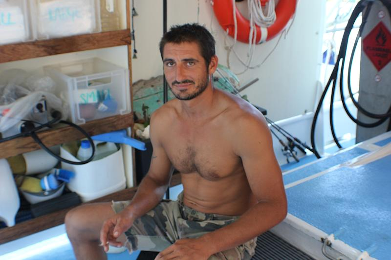 In this photo provided on Monday, April 22, 2013, French fisherman Yoann Galeran sits on board of FV Ruby in Gove Harbour, near Nhulunbuy, Australia. Galeran, 29, said he was swimming from shore to a dinghy about 15 meters (50 feet) away on Sunday night when a crocodile between 2 meters (6 feet 7 inches) and 2.5 meters (8 feet 2 inches) clamped down on his head and neck and attempted to drown him in a maneuver known as a death roll. (AP Photo/Lisa Heathcote, HO) EDITORIAL USE ONLY