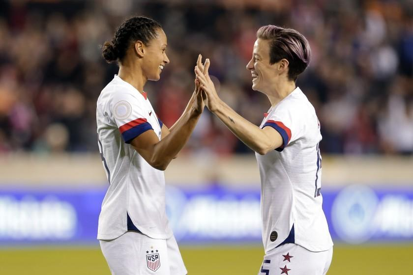 U.S. forwards Lynn Williams and Megan Rapinoe, right, celebrate a goal by Williams during the first half of a CONCACAF women's Olympic qualifying match against Panama on Jan. 31.