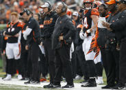 Cincinnati Bengals special assistant Hue Jackson, center, stands on the sideline in the first half of an NFL football game against the Cleveland Browns, Sunday, Nov. 25, 2018, in Cincinnati. (AP Photo/Frank Victores)