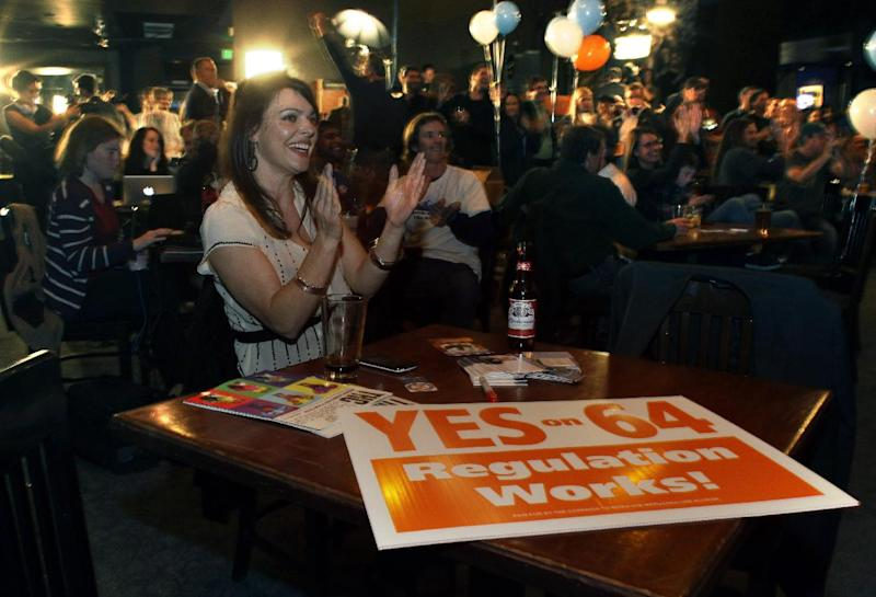 FILE - In this Nov. 6, 2012 file photo, Amanda Jetter celebrates along with others attending an Amendment 64 watch party in a bar after a local television station announced the marijuana amendment's passage, in Denver, Colo. Tuesday's presidential election results showed the American voting public has not only become more permanently diverse in its makeup, but also in its mindset. Voters also altered the course of U.S. social policy, voting in Maine and Maryland to approve same-sex marriage, while Washington state and Colorado voted to legalize recreational use of marijuana. (AP Photo/Brennan Linsley, File)