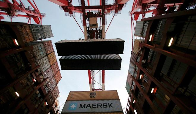Containers are unloaded at a port in Shanghai. The customs authority is investigating a complaint that a foreign company was given access to detailed import and export data that could give it an advantage over local suppliers. Photo: Reuters