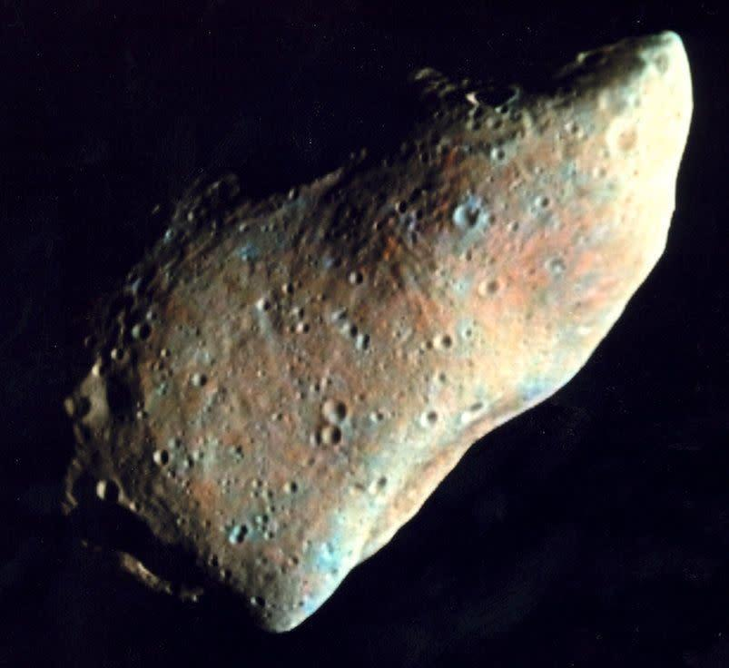 Over 600 craters larger than 100 meters in diameter are seen in this image of the irregularly shaped Gaspra asteroid, photographed by the Galileo spacecraft on Oct. 29, 1991.